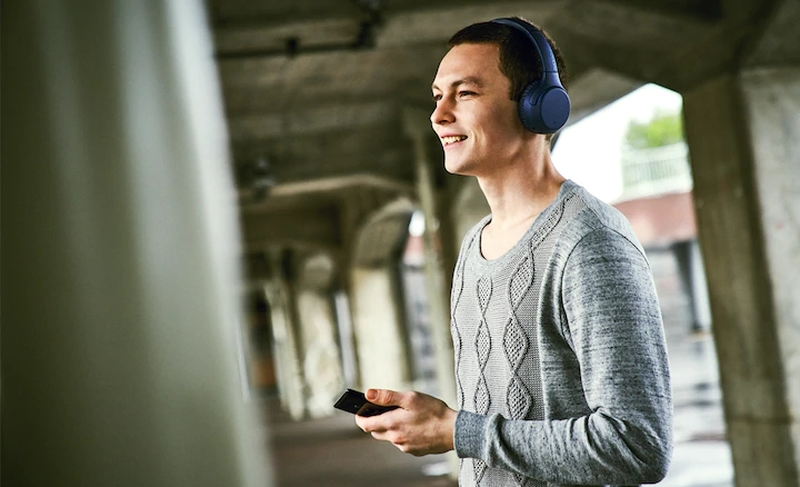 Sony WH-XB700 bluetooth wireless headphones with built-in mic for hands-free calls.