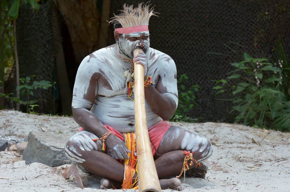 Australian aboriginal playing didgeridoo - healing with sound and vibrations define vibroacoustic therapy (VAT) and assists with relief from anxiety disorders, depression, PTSD, autism and learning difficulties, dementia, stress, pain, insomnia, and more.